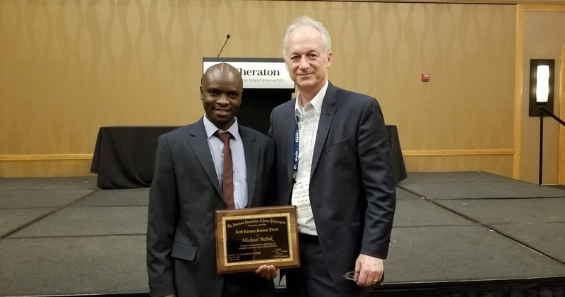 Bruce Stewart-Brown (right), senior vice president of food safety and quality live operations, Perdue Farms, pictured with UD graduate student Michael Balak at the American Association of Avian Pathologists award presentation ceremony in Denver during the American Veterinary Medical Association Convention in July 2018.