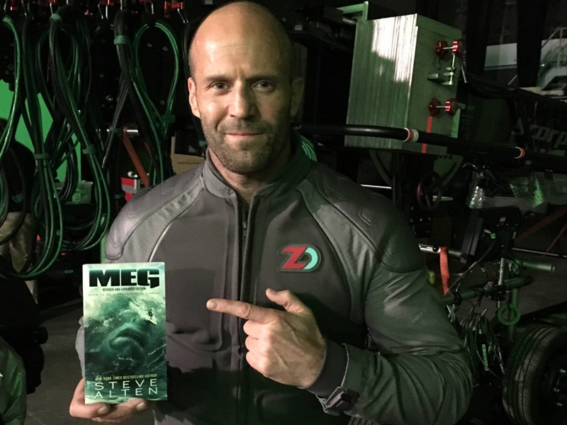 "Actor Jason Statham holds Steve Alten's book, ""Meg,"" which was turned into a movie scheduled for release on Aug. 10."