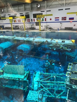 NASA Johnson Space Center Neutral Buoyancy Lab is a deep and wide pool with a mockup of the International Space Station. With help from scuba divers, astronauts train in the pool, which is about as close as one can get on Earth to the zero gravity environment of space.