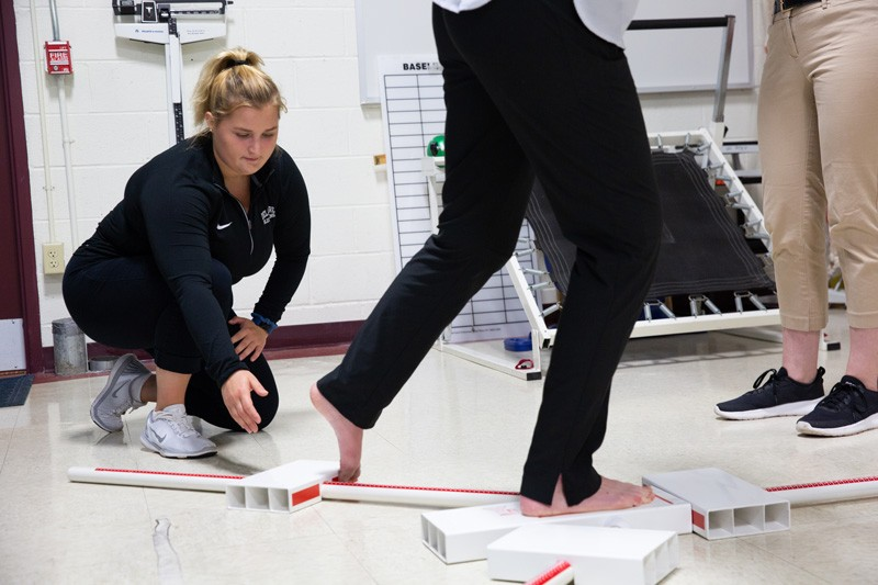 Alissa Strouse conducts research on what is known as the Y-Balance Test, to determine its usefulness in assessing the effects of a concussion.