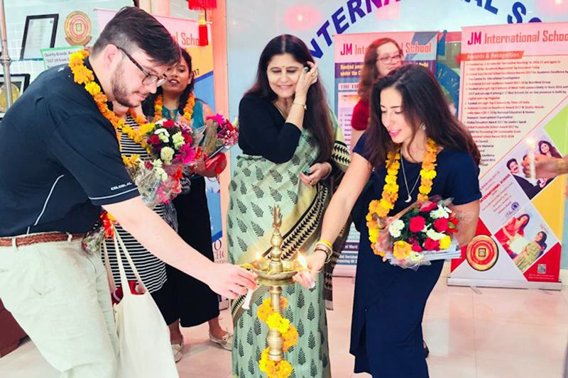 A candle-lighting is customary to welcome U.S. university representatives to the JM International School in Dwarka, New Delhi, India. From left: Patrick Morrison, University of South Dakota International Student Services; Anuradha Govind, principal, JM International School; and Renee Koerner, University of Delaware assistant director of international admissions.