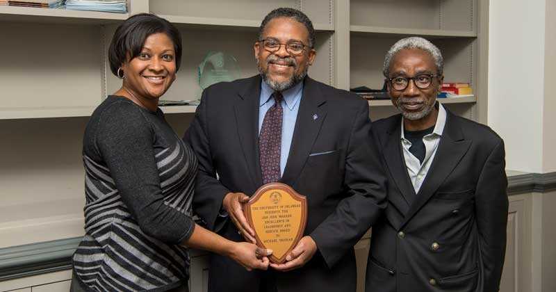 Michael Vaughan (middle), associate dean of academic affairs for the College of Engineering is the recipient of the 2018 John Warren Award. He was presented the award by Darcell Griffith, director of compensation and benefits (left) and nominated by Babatunde Ogunnaike, William L. Friend Chair of Chemical Engineering (right).
