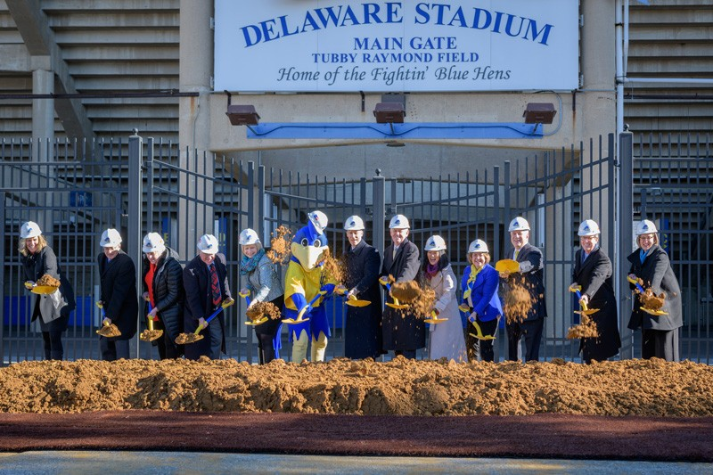 Officials shoveling dirt at the Whitney Athletic Center groundbreaking