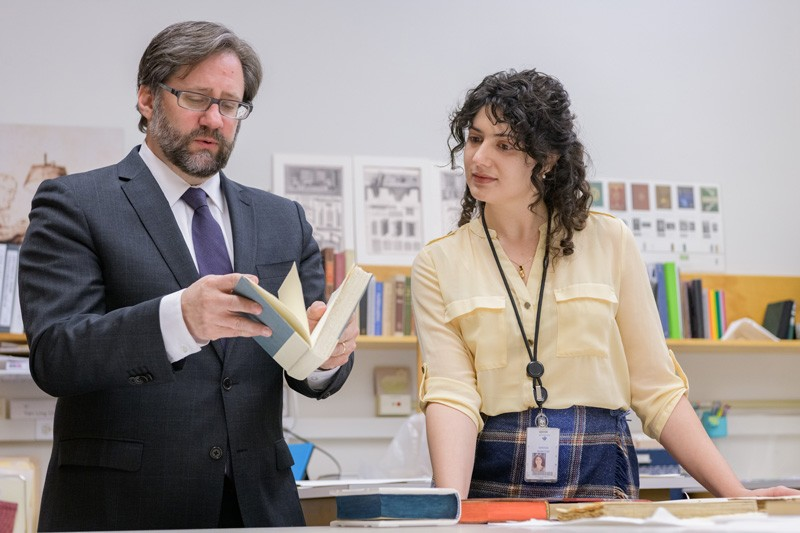 Student Karissa Muratore and NEH Chairman Jon Parrish Peede examine a book in the Winterthur library conservation lab.