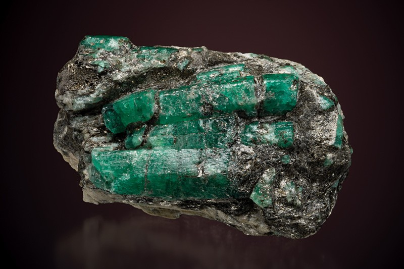 Beryl (variety emerald), from the Takovaya River, Ural Mountains, Russia. This specimen was bought in 1928 from Tiffany & Co by Irénée du Pont but emeralds were first discovered from the deposit in 1830. The width is 10.8 cm.
