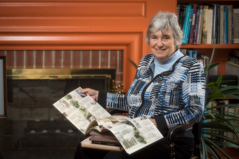 Distinguished Delaware historian Carol Hoffecker holding one of her books.