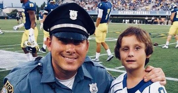 Danny Feltwell (right) joins Detective Bill Wentz on the sidelines at a UD football game.