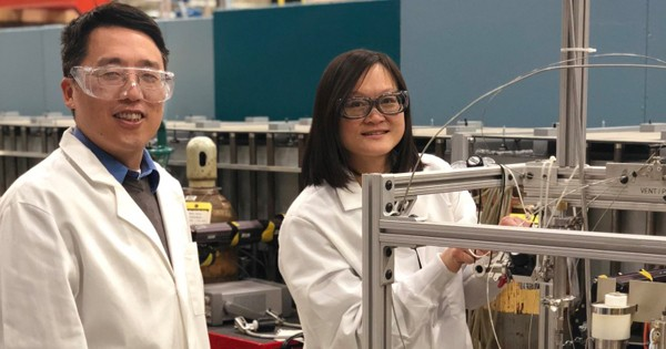 Yun Liu (left) and Wei-Shan Chiang adjust a syringe pump used to control gas pressure.