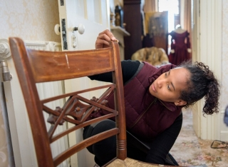 Allison Robinson measures a chair in the Rockwood Museum collection.