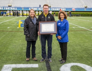Rich Gannon inducted into UDAA Wall of Fame, with AD Chrissi Rawak and Anne Barretta