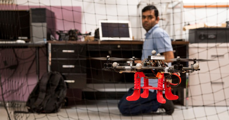 Mechanical engineering doctoral student Indrajeet Yadav flies a drone