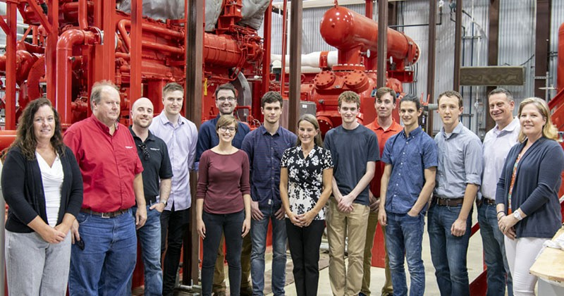 Students in the Delaware Energy Institute's undergraduate research program gather at Eastern Shore Natural's Gas Delaware City-based compression station, hosted by UD alumnus Al Gallo (second from right).