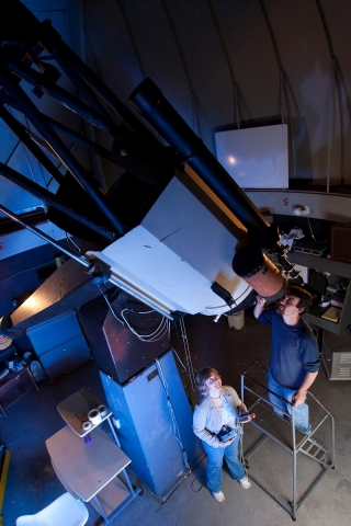 The 24-inch aperture on Mount Cuba's largest telescope gives astronomers a view of galaxies and distant objects in the night sky and has been part of UD astronomers' research and training for decades. Here, Judi Provencal stands by as a student has a look.