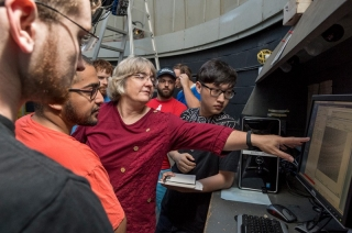 Astronomer Judi Provencal explains data points to University of Delaware students during an astronomy class at Mount Cuba Astronomical Observatory.