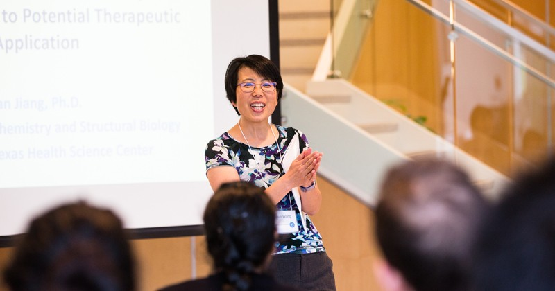 Liyun Wang, director of UD's Center for Biomechanical Engineering Research, addresses the crowd at the 15th annual Biomechanics Research Symposium.