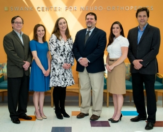 A Delaware team has shown that DNA methylation patterns in circulating blood cells can be used to help identify spastic cerebral palsy (CP) patients. Pictured left to right: Adam Marsh from UD/GenPro and Karyn Robinson, Erin Crowgey, Dr. M. Wade Shrader, Stephanie Yeager, and Robert Akins, from Nemours.