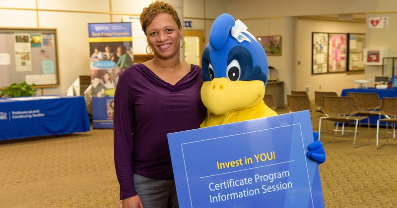 The University of Delaware's Division of Professional and Continuing Studies will host a free information session on July 19 in Wilmington, highlighting professional development programs and educational opportunities for adult students. Assisting at last semester's information session was UD's Baby Blue.