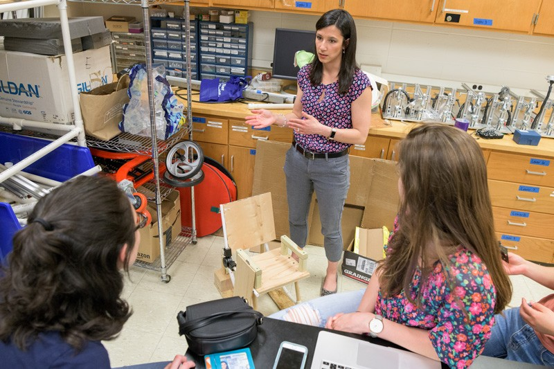 Sarah Rooney, an assistant professor of biomedical engineering at the University of Delaware, advises students as they design a device for children with brittle bone disease.