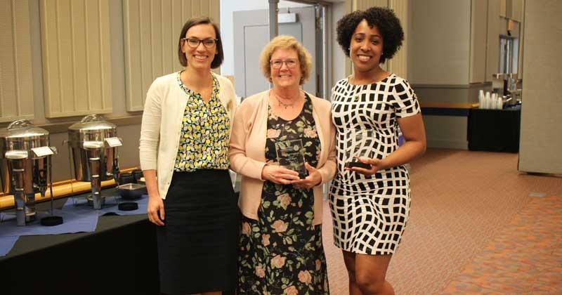 PPE Director Elizabeth Farley-Ripple presents award