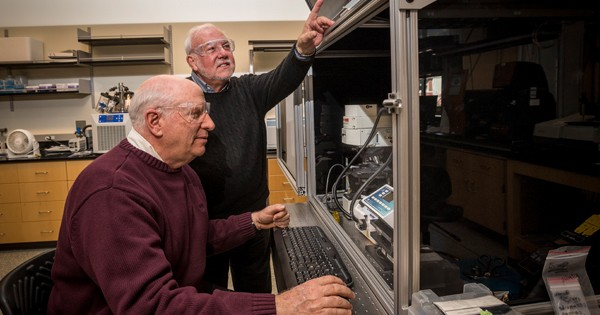 John Rabolt and D. Bruce Chase are pictured in the University of Delaware's Advanced Materials Characterization Lab, which features equipment for X-ray diffraction, thermal analysis, porosity and particle size, vibrational spectroscopy and mass spectrometry.