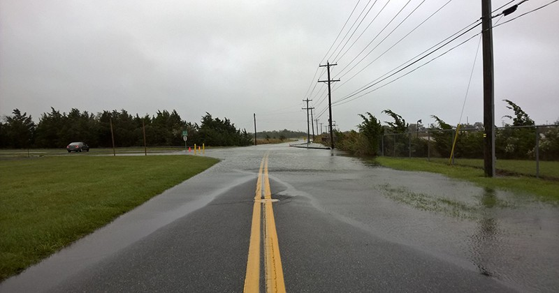Coastal flooding on Pilottown Road in Lewes, Delaware