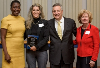 Bessie B. Collins award winner Effie Halakos, a doctoral  student in biological sciences (second from left), accepts congratulations from UD Vice Provost for Diversity Carol Henderson (left), UD President Dennis Assanis and Interim Provost Robin Morgan.