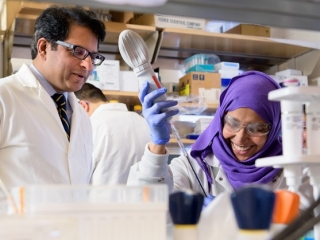 University of Delaware biologist Salil Lachke's research focuses on eye lens development. Here, he works in the lab with graduate student Salma Alsaai.