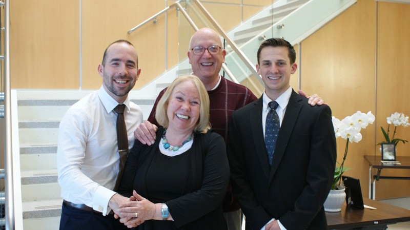 Physical therapy graduate students Dan Chapman (left) and Tyler Tice (right) pose with Dana and Leslie Shreve, whose mother Ginny donated her body to the University of Delaware College of Health Sciences.