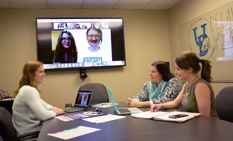 Seated left to right: Kathleen McCallops, Cory Gilden and Ginnie Sawyer Morris, doctoral students in Human Development and Family Sciences, connect virtually with colleagues in Greece and Germany to develop a conference that fosters collaborative research.