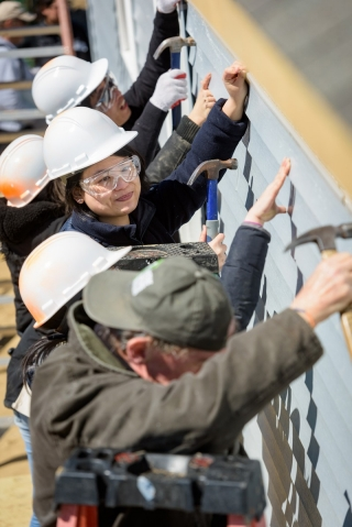 UD students from China, India, Malaysia, Mexico, Romania and Swaziland helped Habitat for Humanity build a house for a family in Sussex County.