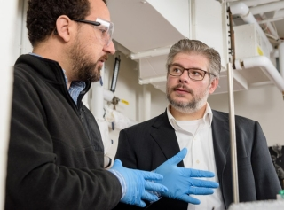 University of Delaware Professor Joel Rosenthal (right) and postdoctoral fellow Abderrahman Atifi are working on a new approach to reducing carbon dioxide emissions.
