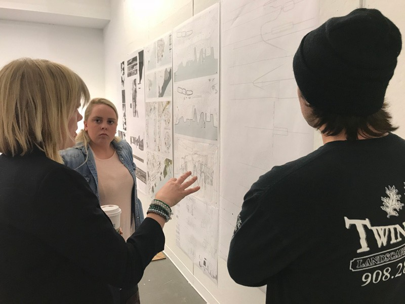 UD Department of Plant and Soil Sciences Assistant Professor Anna Wik (left) explains the PennDesign projects  to students.
