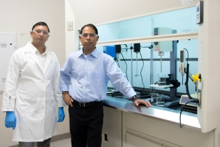 RiKarbon founder Basudeb Saha (right) and Kumar Babu Kautharapu, RiKarbon scientific officer, are combining biomass and natural oils to create greener alternatives to petroleum-based oils.