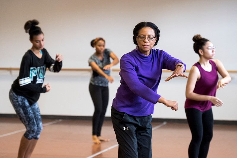 "Lynnette Overby (second from right) leads a rehearsal in UD's dance studio of ""Dave the Potter,"" a collaborative, multidisciplinary performance project that premiered at UD in 2014, with Overby as the art director and choreographer."