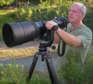 University of Delaware professor Doug Tallamy with camera