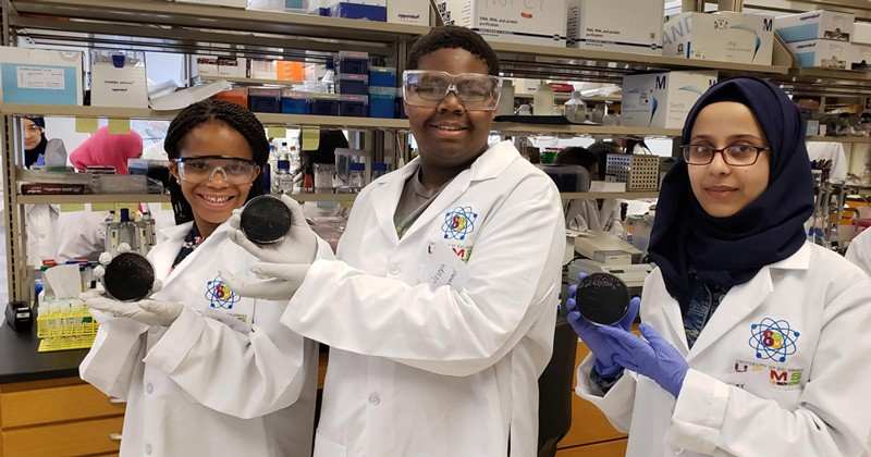 High school students in UD's Upward Bound program spent several weeks this summer in Prof. Ramona Neunuebel's lab, getting to know what it's like to do research and work as a scientist. In this photo are (left to right): Victoria Wiley, Joseph Raymond and Hager Qasim.