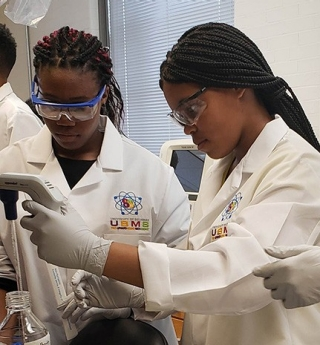 Upward Bound students — including Tranicka Harrell and Marissa Brown — learned important lab skills during a summer program in Prof. Ramona Neunuebel's lab.