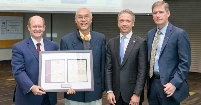 UD physicist Siu-Tat Chui (second from left) was recognized with a ceremonial patent during an event on protecting American innovation and intellectual property on Friday, Sept. 21. Pictured with Chui are (from left) U.S. Sen. Chris Coons, Andrei Iancu, U.S. Patent and Trademark Office director and Charles G. Riordan, UD vice president for research, scholarship and innovation.