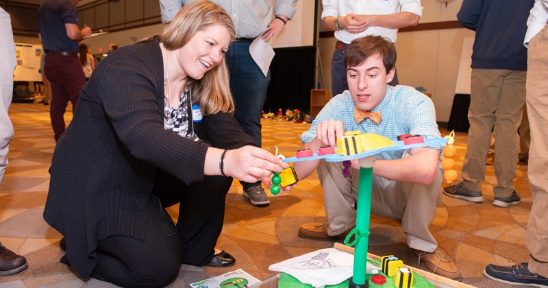 Carrie Aitkenhead, education outreach coordinator at Melissa and Doug, evaluates a toy with Christopher Hodges, a mechanical engineering student at UD.