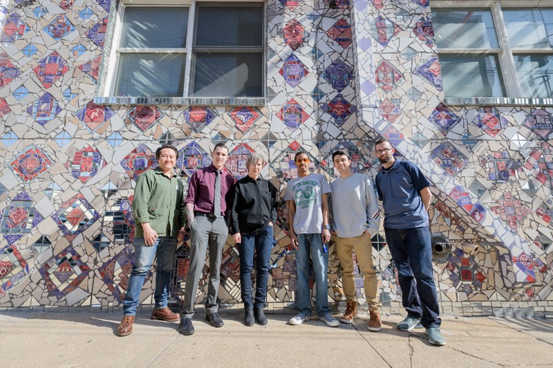 Gathered across Shipley Street from the Creative Vision Factory are (from left) David Kim, Joshua Stout, Anne Bowler, Geraldo Gonzalez, Dillon DiGuglielmo and Michael Kalmbach, standing in front of a mural designed and installed by CVF artists on the wall of the Christina Cultural Arts Center in Wilmington.