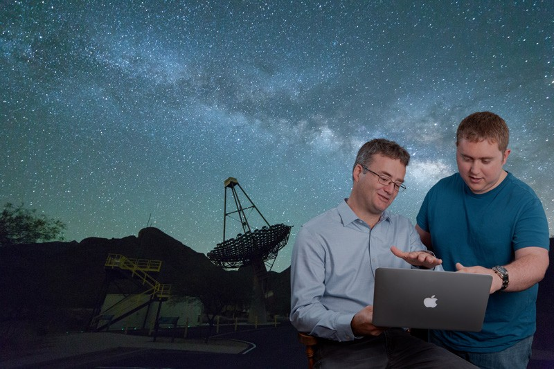 UD Professor Jamie Holder (left) and doctoral student Tyler Williamson are part of an international team that has developed a new method for measuring the size of stars. The technique hinges on the unique capabilities of the VERITAS telescopes in the Arizona desert (shown in the background) and on asteroids passing by at the right place and time.