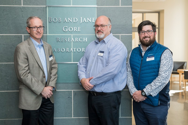 Gore's Greg Hannon (left), Jeffrey Ledford (center) and John Delluca (UD alumnus) stand outside the Bob and Jane Gore Research Laboratory.  W. L. Gore and Associates, Inc., a long standing partner with UD to advance research and discovery, donated funds for UD's first 3D X-ray imaging system, which is located in the Advanced Materials Characterization Lab.