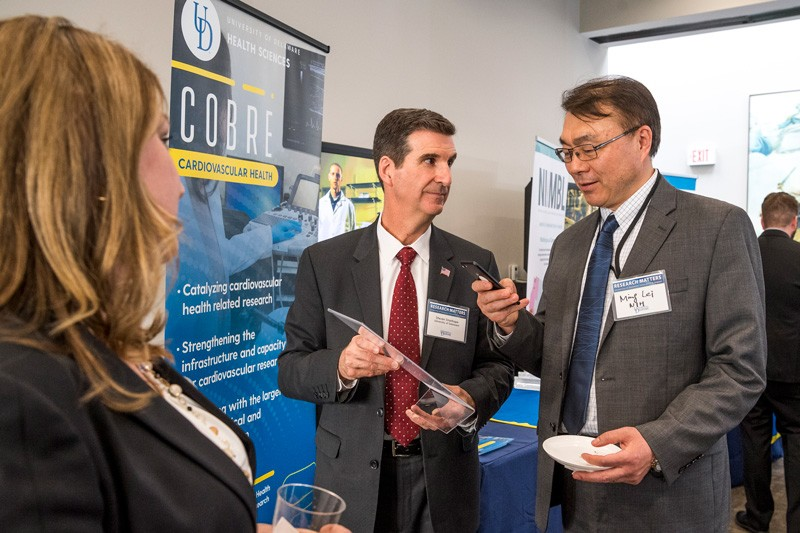 """UD Day in DC"" attracted leaders from federal agencies that support UD research. Here, Steven Stanhope, associate vice president for research at UD and director of Delaware INBRE, (center) talks with Ming Lei of the National Institutes of Health."