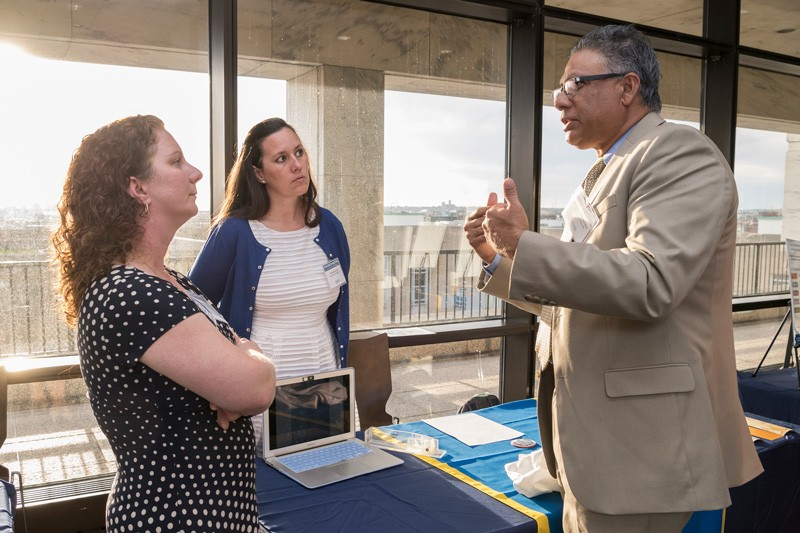 "University of Delaware researchers Jen Biddle (left) and Danielle Dixson of Marine Biosciences in the College of Earth Ocean and Environment talk with Anshuman ""A.R."" Razdan, associate vice president for research development at UD."