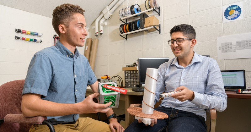 UD undergraduates Jeffrey Neumann (left) and Ahmad Tamimi are working on the power system and communications software for the ground stations for NASA's CURIE mission.