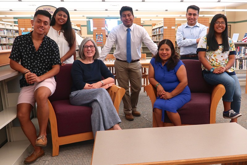Standing are (left to right) Johnny Perez-Gonzalez, Lindsey Perez-Perez, William Garcia-Garcia, Rony Baltazar-Lopez, and Iris Perez-Mazariegos. April Veness is seated on the left and Aracely Garcia is seated on the right.