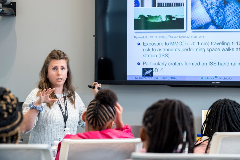 Maria Katzarova, a postdoctoral researcher in the laboratory of Norman Wagner, the Unidel Robert L. Pigford Chair in Chemical Engineering, talked to girls from Girls Inc. of Delaware about shear thickening fluid, a puncture-resistant material under development for use in spacesuits.