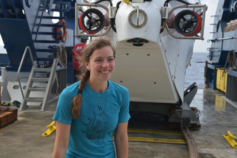 Emily Estes, a former post-doctoral researcher at UD, stands near the human occupied vehicle Alvin following the successful completion of her first dive.
