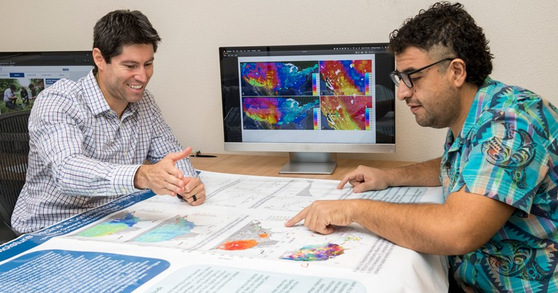 Rodrigo Vargas (left), associate professor of ecosystem ecology and environmental change at the University of Delaware, and doctoral student Mario Guevara have developed a new, more accurate way to map predicted soil moisture, even in areas where no data have been available.