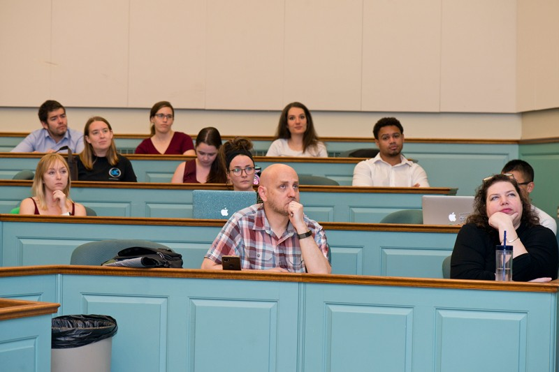 University of Delaware professors Joshua Zide (materials science and engineering) and Dawn Fallik (English) sit on the front row as students explain their research in the final event of the 2019 Words For Nerds program. Zide and Fallik created the program to help students develop effective communication skills.